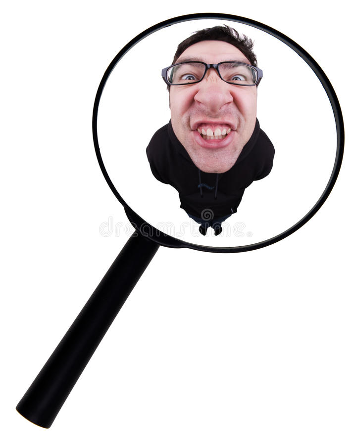 Mann und eine Lupe lizenzfreies stockbild