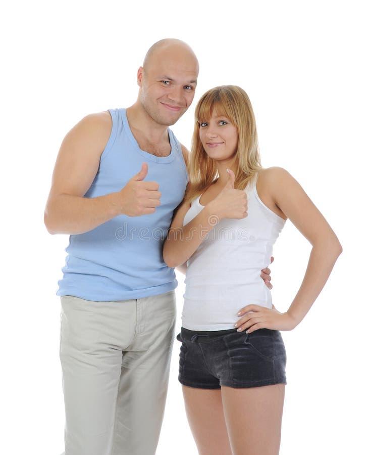 Mann und Frau mit dem Daumen stockbild