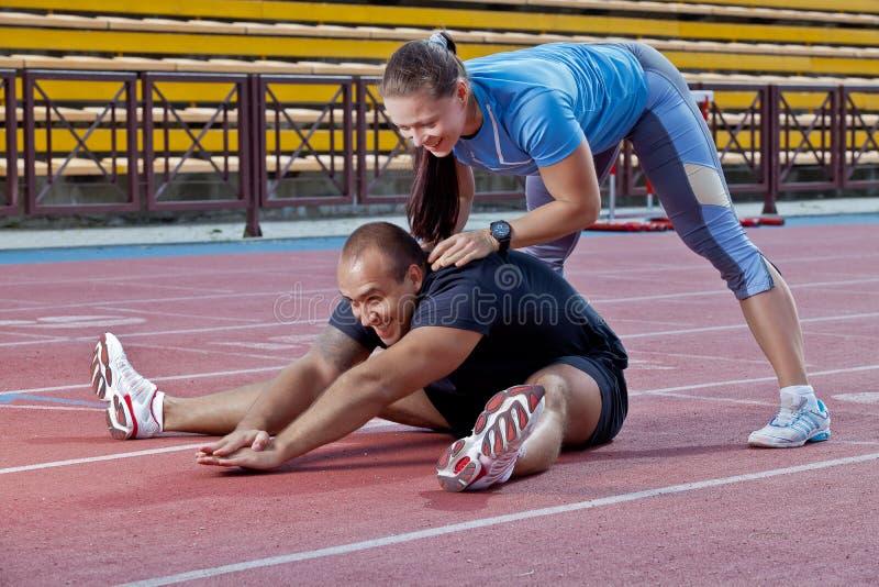 Mann und Frau am Stadion lizenzfreies stockfoto