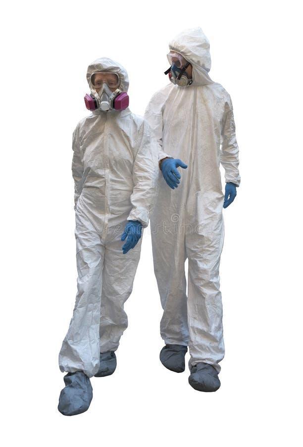 Mann und Frau tragende hazmat Anzüge stockfotografie