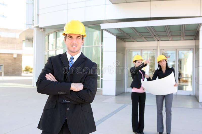 Mann-und Frauen-Architekten-Team lizenzfreie stockbilder