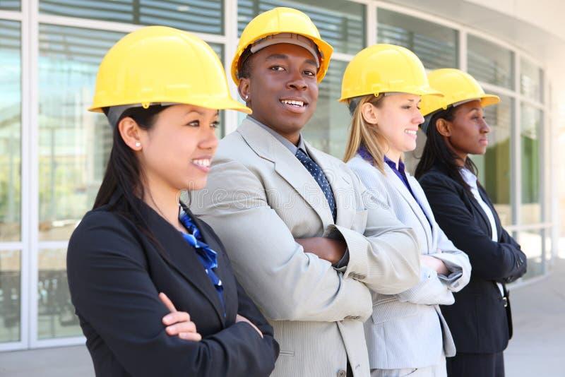 Mann-und Frauen-Aufbau-Team stockbild