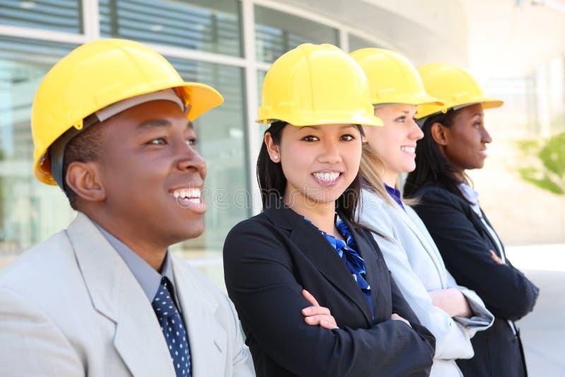 Mann-und Frauen-Aufbau-Team stockfoto