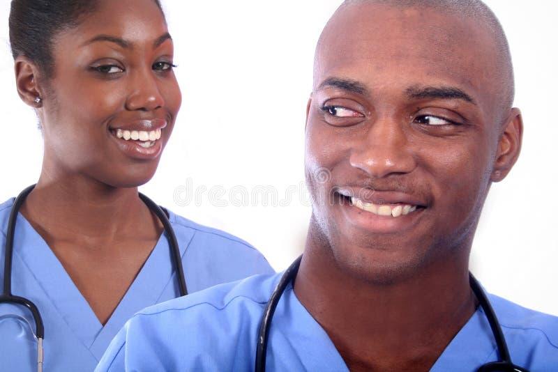 Mann-und Frauen-medizinisches Feld lizenzfreie stockfotos