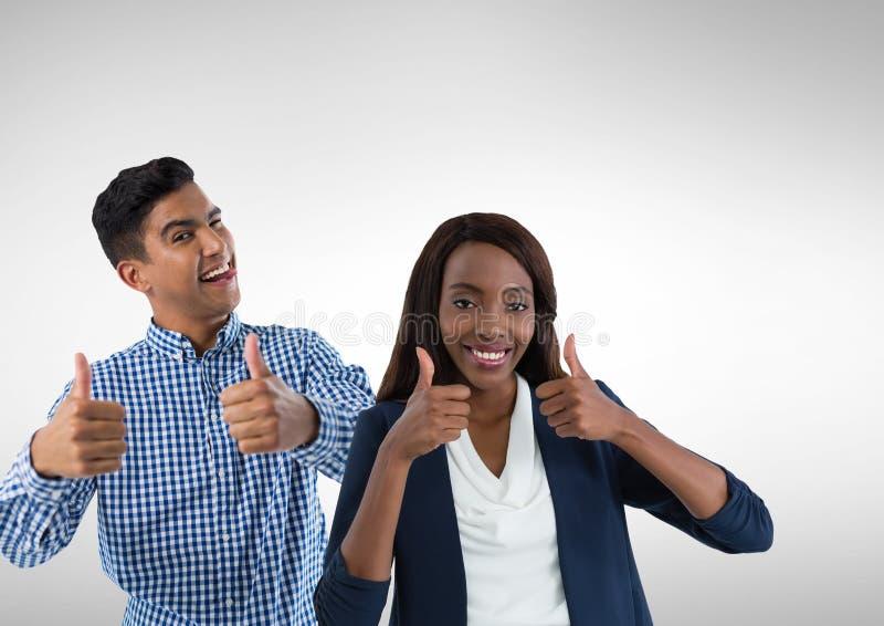 Mann und Frauen mit den Daumen oben stockbilder