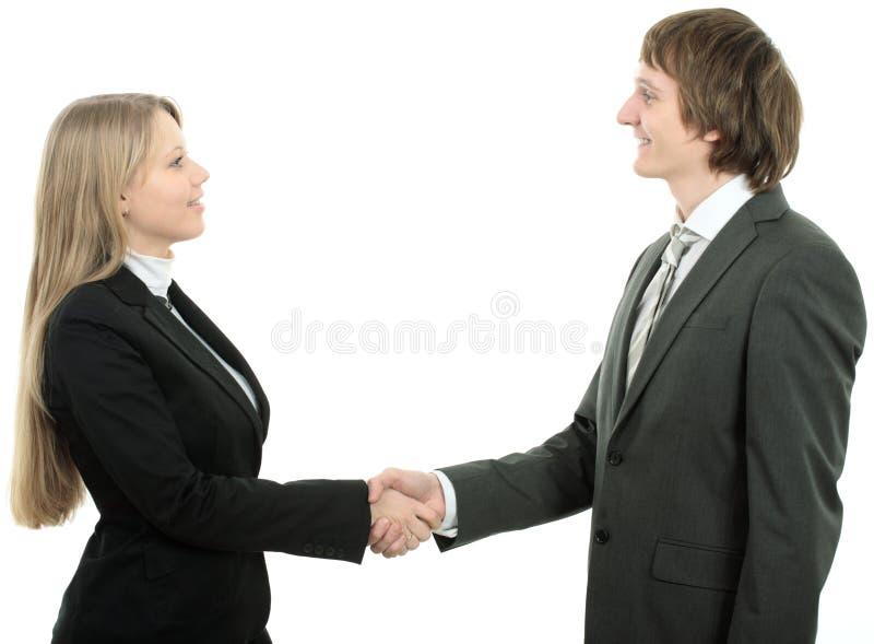 Mann- und Frauengeschäftsteam, das Hände rüttelt lizenzfreie stockbilder