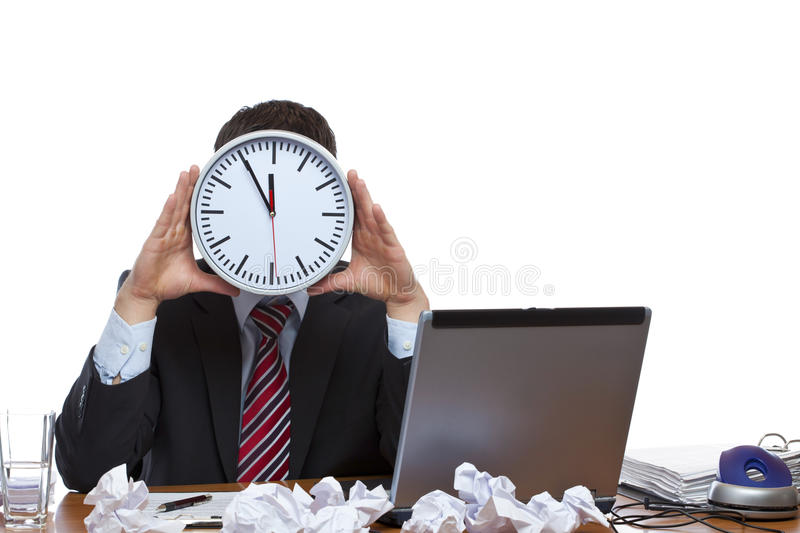 Mann Under Time Pressure With Clock At Face Royalty Free Stock Photography