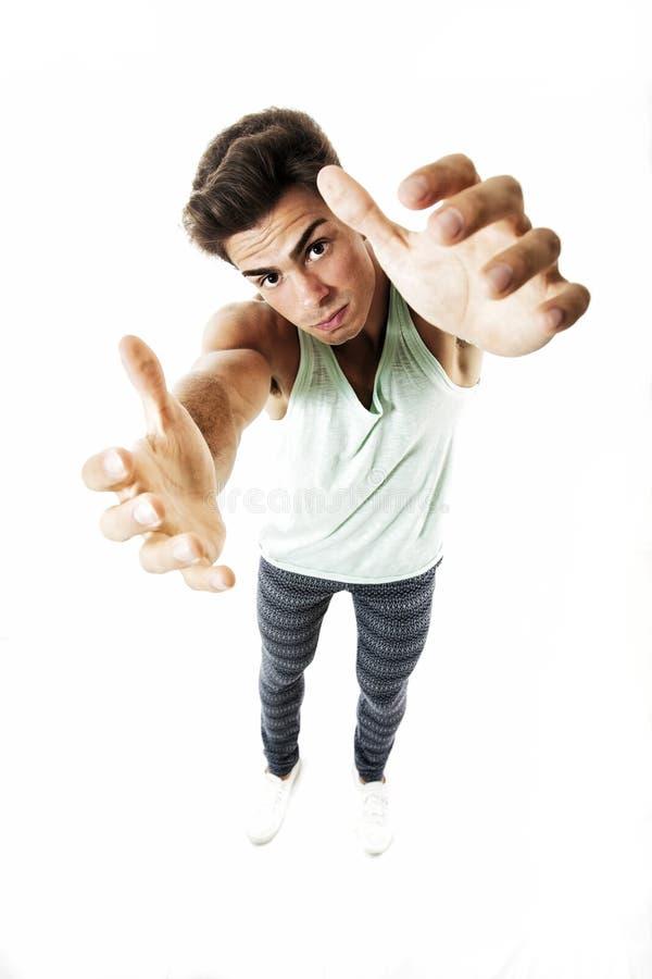 Mann vom oben genannten Versuchen, etwas zwei Hände auf Weiß nehmend stockbilder