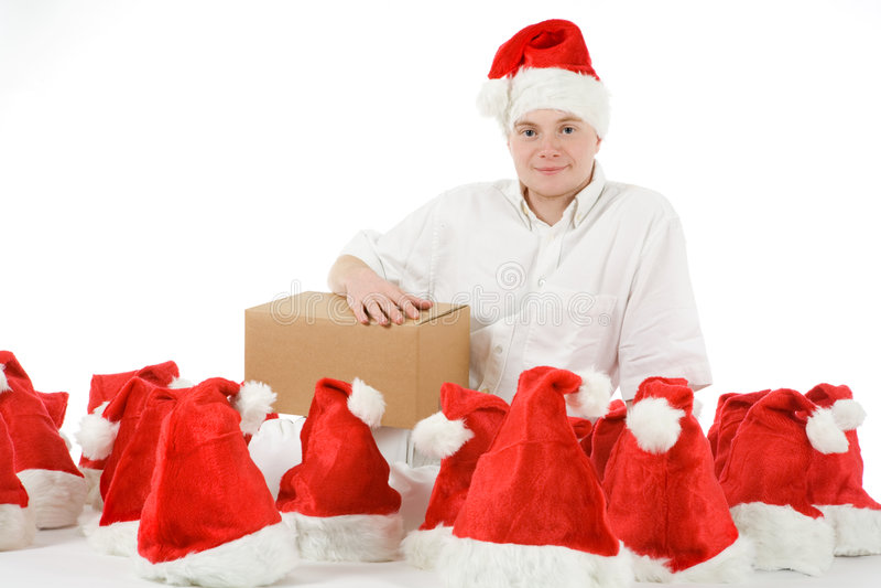 Mann zwischen vielen Weihnachtshüten lizenzfreie stockfotografie