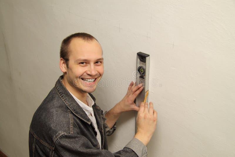 Mannabbausohle. Original misst die Wand. lizenzfreie stockbilder