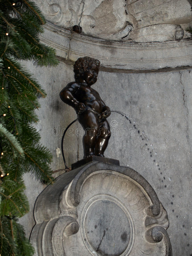 Manneken Pis. Also known in French as le Petit Julien), is a famous Brussels landmark stock image