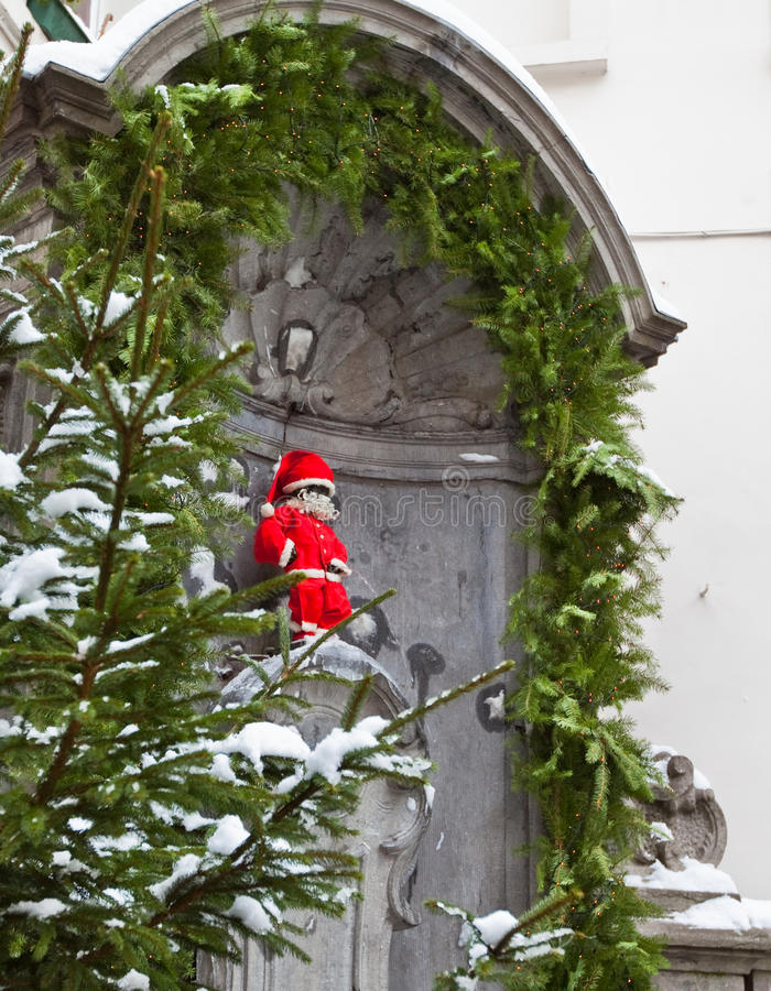 Manneken Pis as Santa. Famous statue of Manneken Pis in Brussels, Belgium wearing Santa Claus clothing for Christmas stock photos
