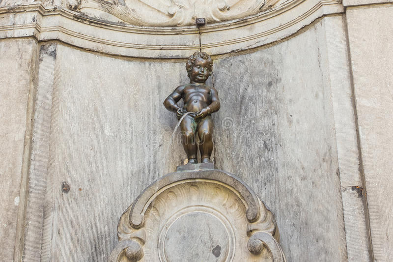 Manneken Pis in Brussels, Belgium. BRUSSELS - MAY 16: Close Up from Manneken Pis statue on May 16, 2014 in Brussels, Belgium. This statue is landmark of Brussels royalty free stock photography