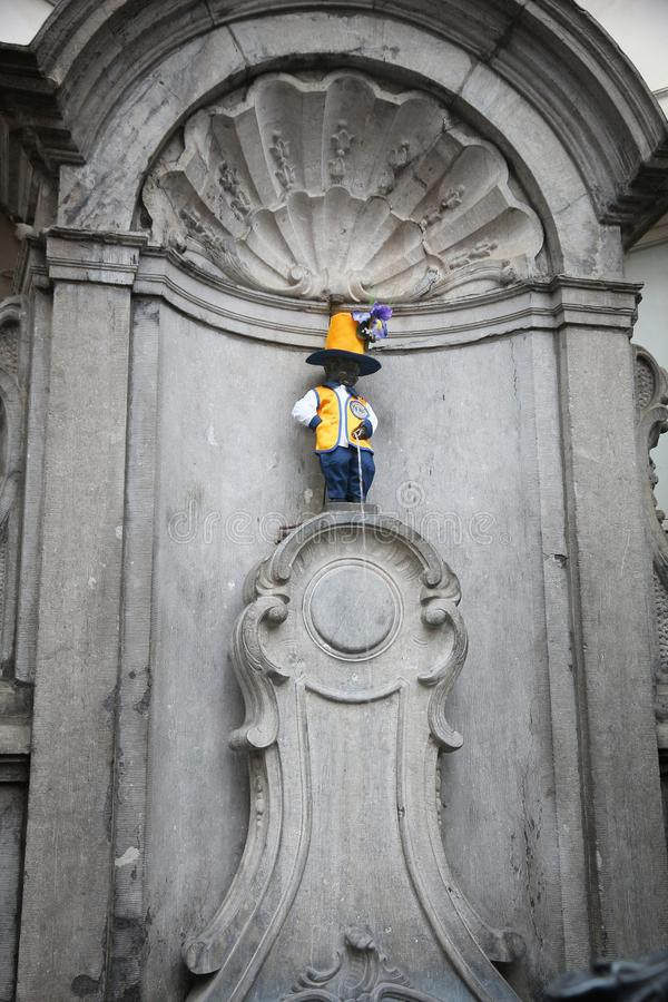 Manneken Pis costume. BRUSSELS, BELGIUM - NOVEMBER 19, 2016: Manneken Pis peeing boy fountain in Brussels. The boy wears one of his 950 costumes, this time Lions stock photo
