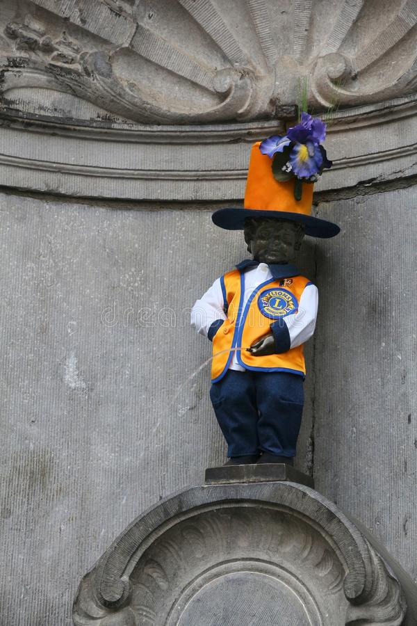 Manneken Pis costume. BRUSSELS, BELGIUM - NOVEMBER 19, 2016: Manneken Pis peeing boy fountain in Brussels. The boy wears one of his 950 costumes, this time Lions royalty free stock photos