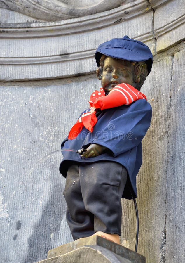 Manneken Pis in new costume. BRUSSELS, BELGIUM-SEPTEMBER 26: Manneken Pis awarded costume of folkloric personage of Schaerbeek Pogge on September 26, 2013 in royalty free stock image