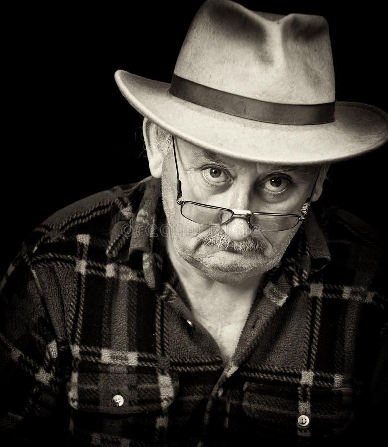 mannelijk knorrig portret stock foto