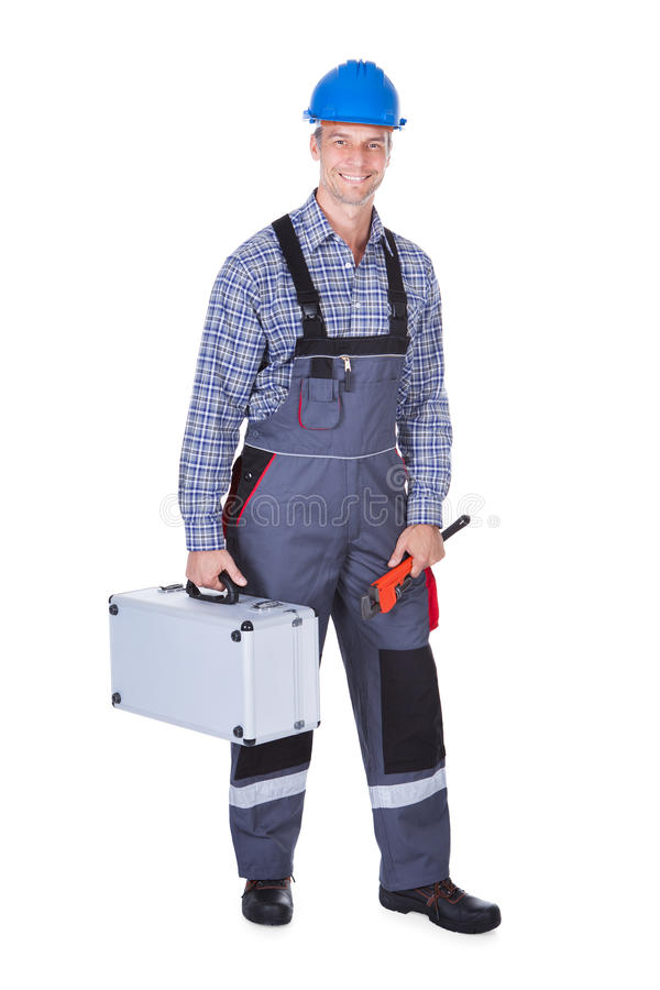 Mannelijke arbeider met toolkit stock foto