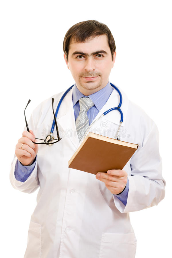 Mannelijke arts met een stethoscoop en een boek stock foto