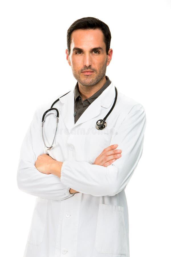 Mannelijke arts met gekruiste wapens en stethoscoop stock afbeelding