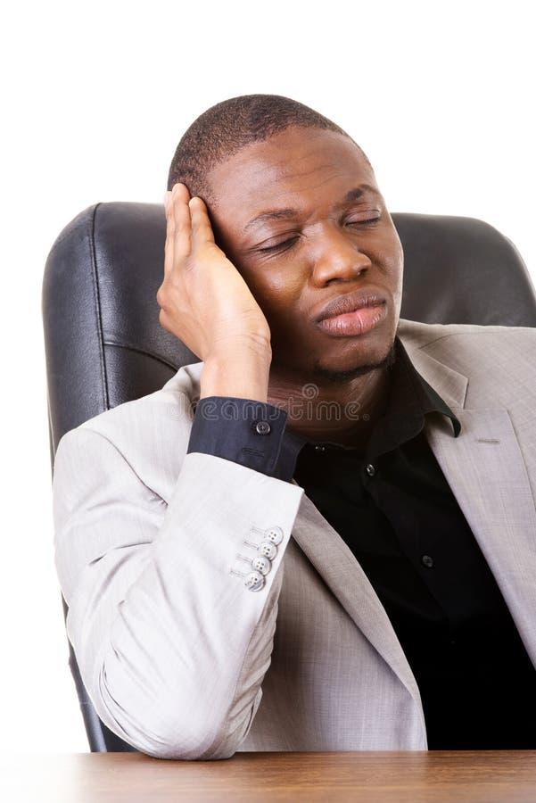 Mannelijke bored zakenmanzitting. royalty-vrije stock fotografie