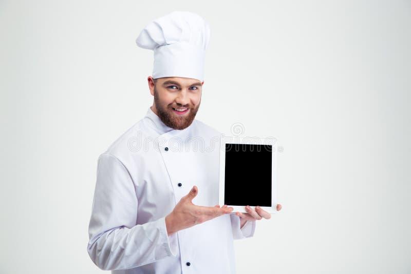 Mannelijke chef-kokkok die het lege scherm van de tabletcomputer tonen royalty-vrije stock foto's