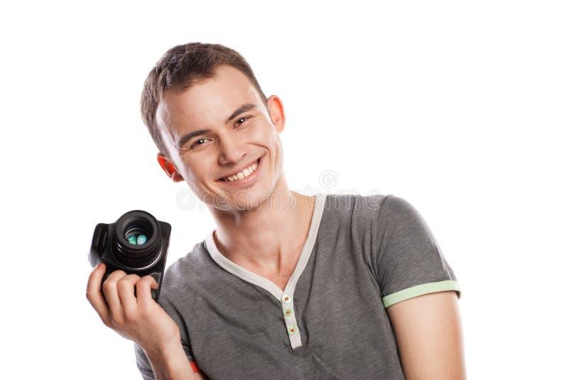 Mannelijke fotograaf met camera die op wit wordt geïsoleerdi stock afbeelding