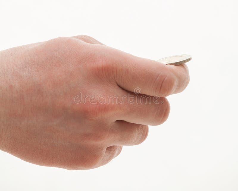 Mannelijke hand die een muntstuk houden royalty-vrije stock afbeeldingen