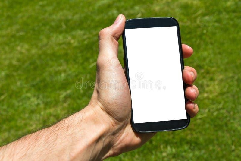 Mannelijke hand die slimme telefoon houden stock afbeeldingen