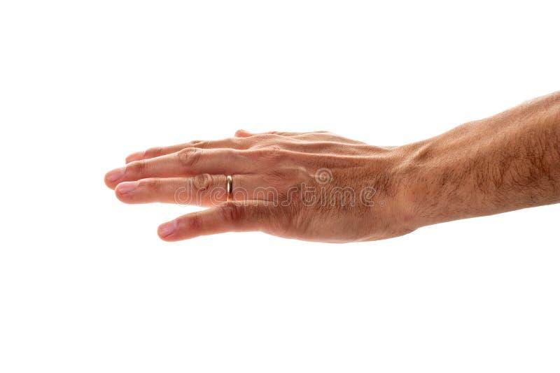 Mannelijke hand met een trouwring die een gebaar van bescherming en het strijken tonen stock foto's
