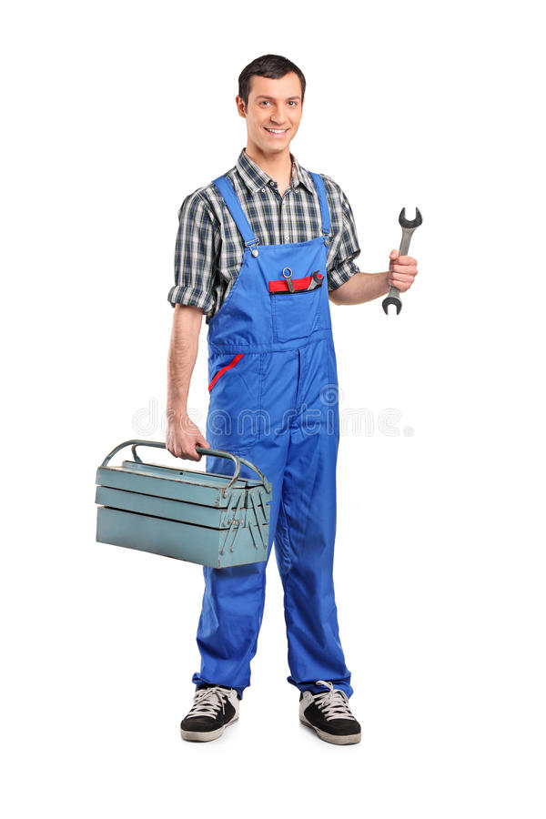 Mannelijke handarbeider die een moersleutel en toolbox houdt stock afbeeldingen