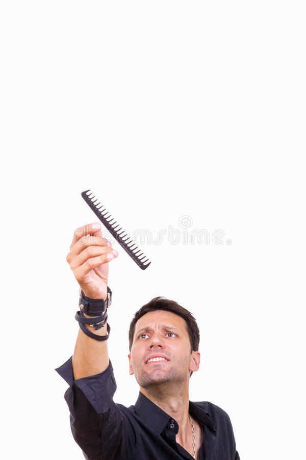 Mannelijke kapper die kam vangen royalty-vrije stock afbeeldingen
