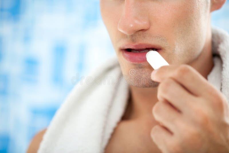 Mannelijke lippenzorg royalty-vrije stock afbeeldingen