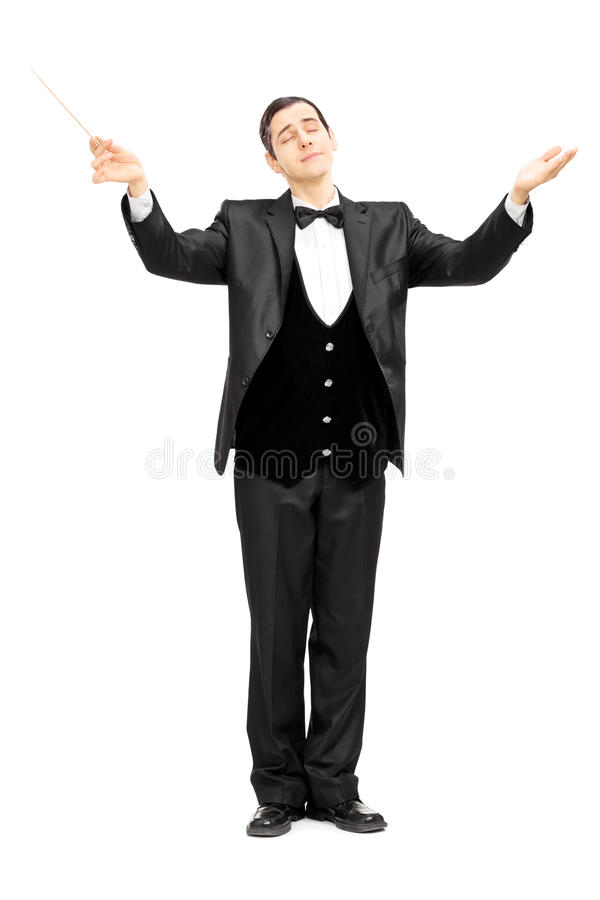 Mannelijke orkestleider die met knuppel leiden stock afbeelding