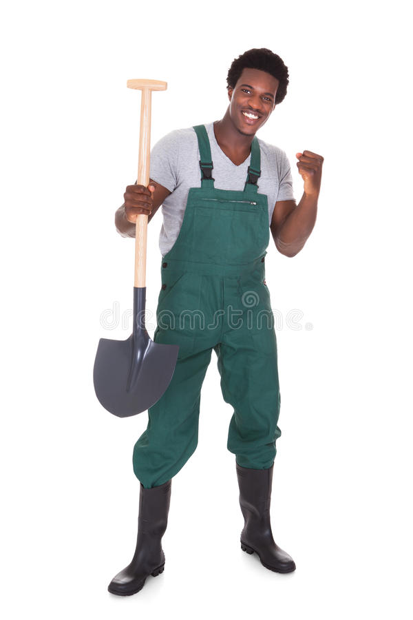 Mannelijke Tuinman Holding Shovel stock afbeelding