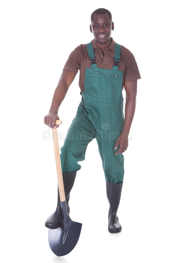 Mannelijke tuinman met schop royalty-vrije stock foto