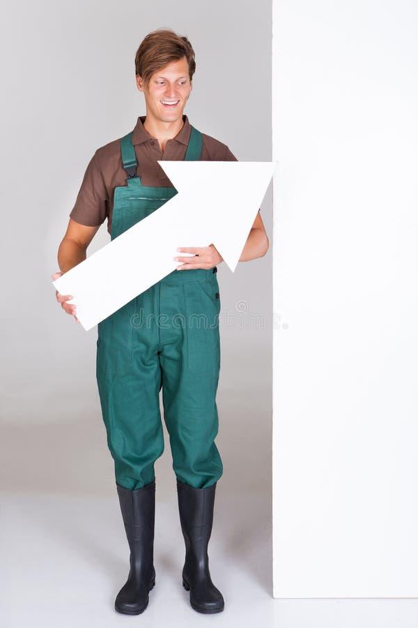 Mannelijke Tuinman Presenting Blank Placard stock foto
