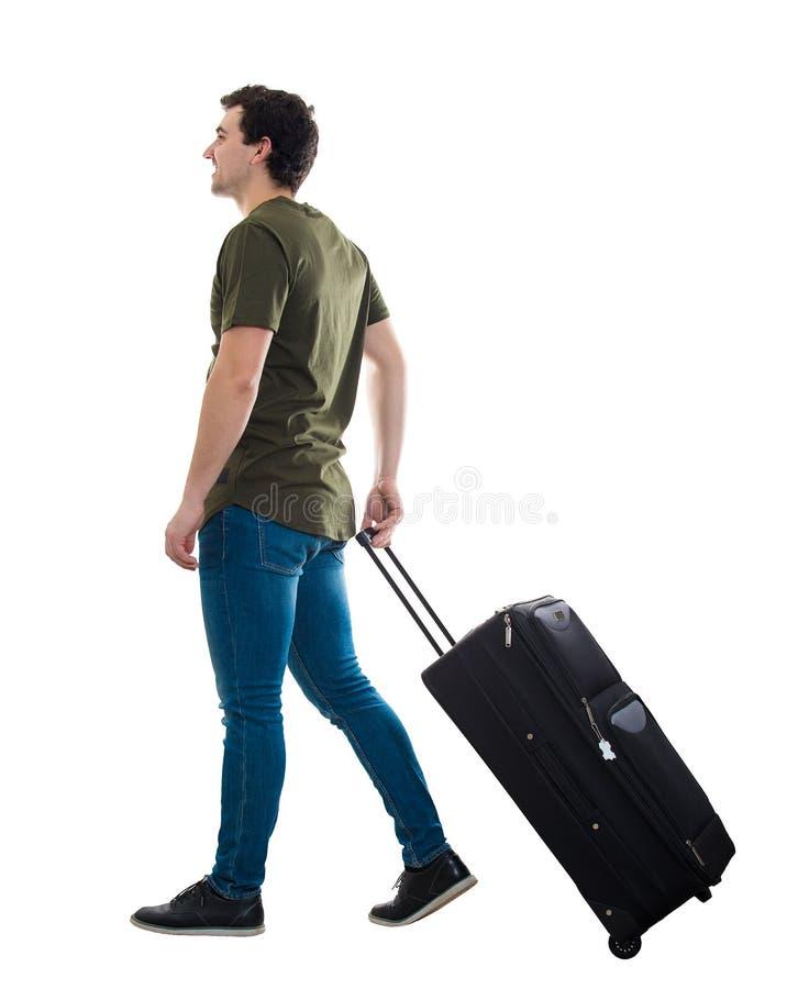 Mannen bär bagage royaltyfria foton