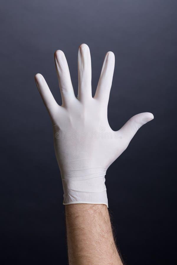 Download Mannen Gömma I Handflatan I Latexhandske Arkivfoto - Bild av folk, mörkt: 37348358