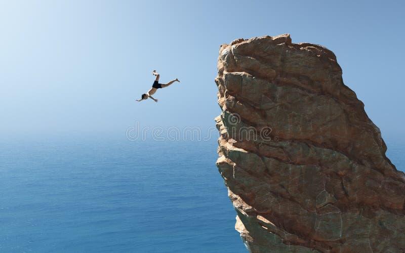 Mannen hoppar in i havet arkivbilder