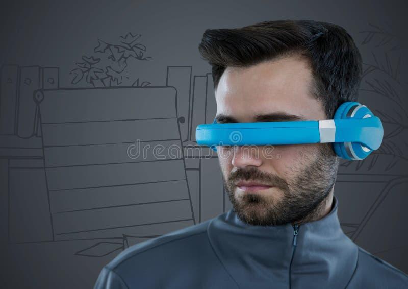 Mannen i blå virtuell verklighethörlurar med mikrofon mot grå färger räcker det utdragna kontoret royaltyfri foto