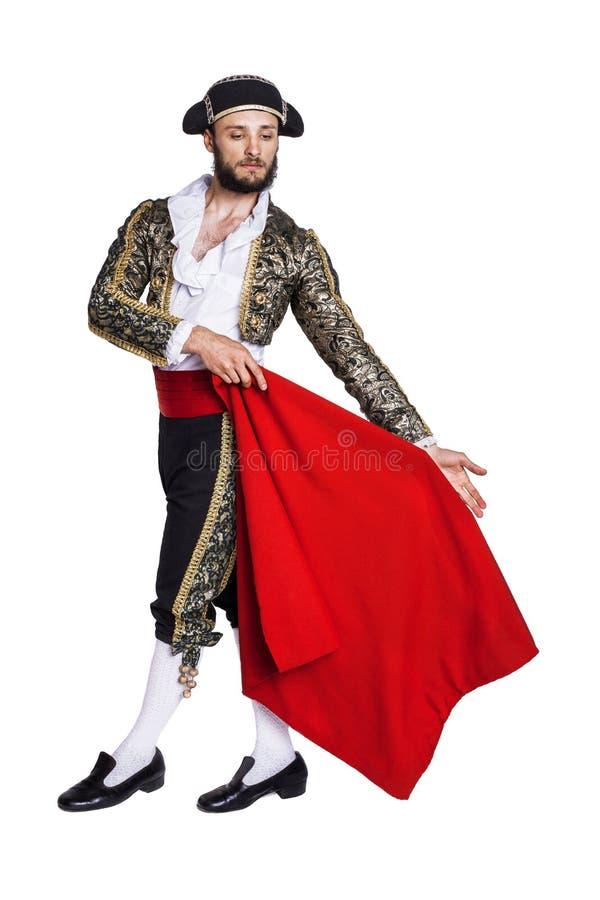 Mannen klädde som matador på en vit bakgrund royaltyfri fotografi