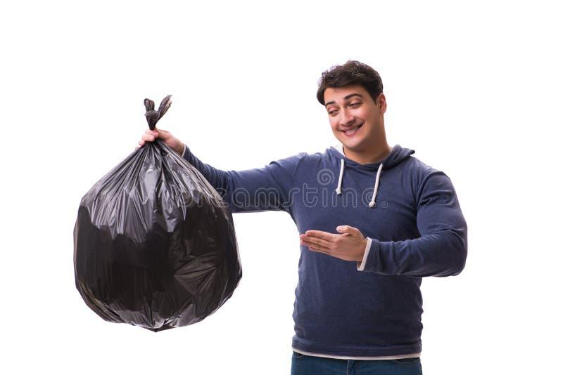 Mannen med avskrädesäcken som isoleras på vit royaltyfri bild