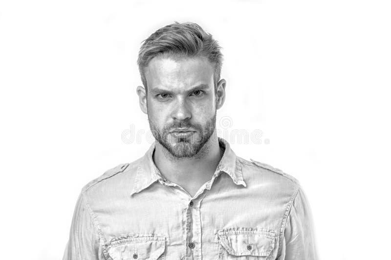 Mannen med borstet på strikt framsida ser allvarlig vit bakgrund Mannen med skägget ser stilig och brutally grabb med arkivfoto