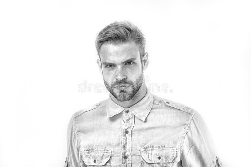 Mannen med skägget ser stilig och brutally Mannen med borstet på strikt framsida ser allvarlig vit bakgrund grabb med royaltyfri fotografi