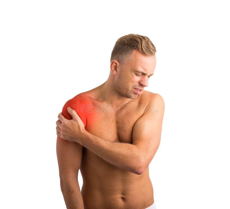 mannen smärtar skulderen royaltyfri foto