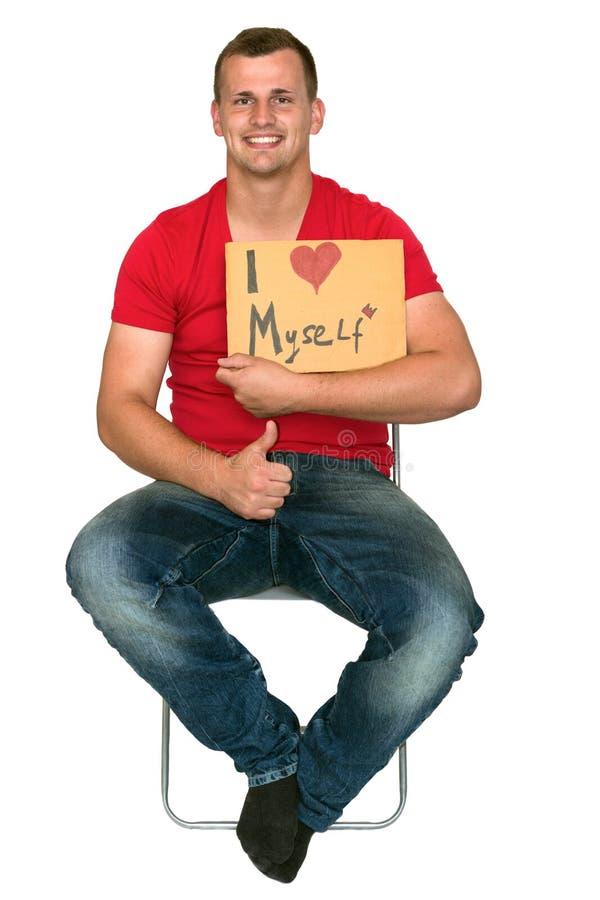 Mannen som är jätteglad med älskar jag, jag själv tecknet fotografering för bildbyråer