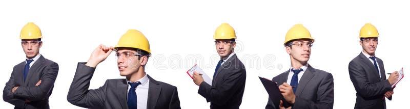 Mannen som bär den hårda hatten som isoleras på vit arkivfoton