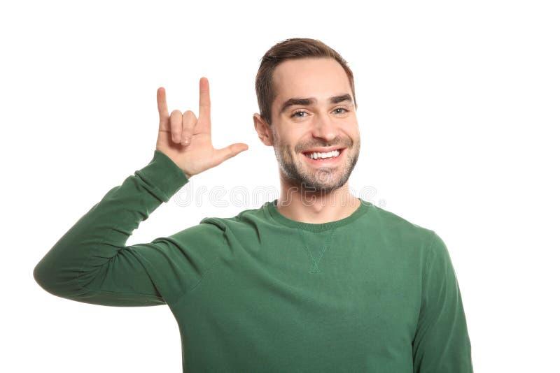 Mannen som visar ÄLSKAR JAG, DIG gesten i teckenspråk på vit arkivbilder