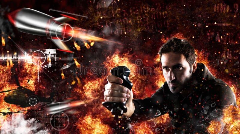 Mannen spelar med videogames med styrspaken en krigstrid royaltyfri foto